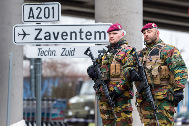 Belgian Army soldiers patrol at Zaventem Airport in Brussels on Wednesday, March 23, 2016. Belgian authorities were searching Wednesday for a top suspect in the country's deadliest attacks in deca ...