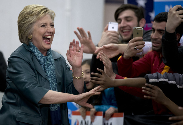 Democratic presidential candidate Hillary Clinton arrives to speak at a campaign event at Rainier Beach High School in Seattle, Tuesday, March 22, 2016. (AP Photo/Carolyn Kaster)
