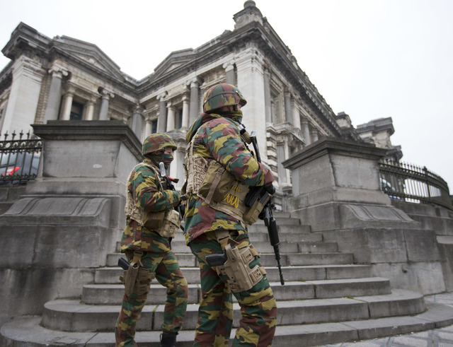 Belgium soldiers patrol around the main court building where Salah Abdeslam, the top suspect in last year's deadly Paris attacks, was expected to appear before a judge in Brussels, Belgium, Thursd ...