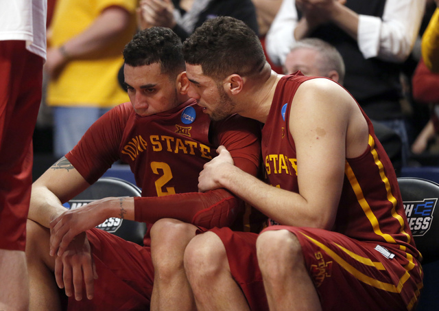 Iowa State's Abdel Nader talks to Georges Niang int he final sends of a college basketball game against Virginia in the regional semifinals of the NCAA Tournament, Friday, March 25, 2016, in Chica ...