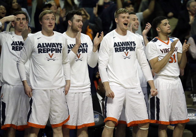 Players on Virginia bench react during the second half of a college basketball game against Iowa State in the regional semifinals of the NCAA Tournament, Friday, March 25, 2016, in Chicago. Virgin ...