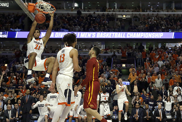Virginia's Isaiah Wilkins (21) dunks during the second half of a college basketball game against Iowa State in the regional semifinals of the NCAA Tournament, Friday, March 25, 2016, in Chicago. ( ...