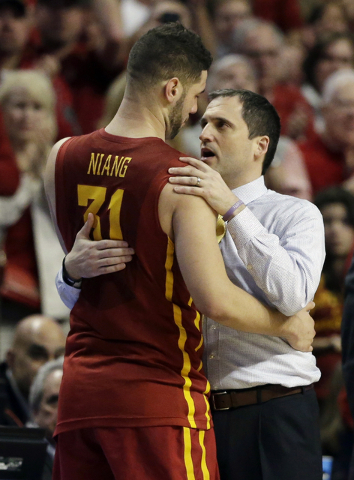 Iowa State's head coach Steve Prohm, right, talks to Iowa State's Georges Niang (31) in the final seconds of a college basketball game against Virginia in the regional semifinals of the NCAA Tourn ...