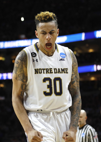 Notre Dame's Zach Auguste reacts during the second half of the team's NCAA college basketball game against Wisconsin in the regional semifinals of the men's NCAA Tournament, Friday, March 25, 2016 ...