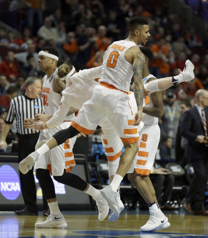 Syracuse's Michael Gbinije (0) and Syracuse's Christian White (55) celebrate after a play during the second half of a college basketball game against Gonzaga in the regional semifinals of the NCAA ...