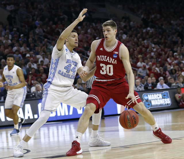 Indiana's Collin Hartman (30) tries to get past North Carolina's Justin Jackson (44) during the first half of an NCAA college basketball game in the regional semifinals of the men's NCAA Tournamen ...