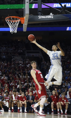 North Carolina's Justin Jackson shoots as Indiana's Ryan Burton defends during the first half of an NCAA college basketball game in the regional semifinals of the men's NCAA Tournament, Friday, Ma ...