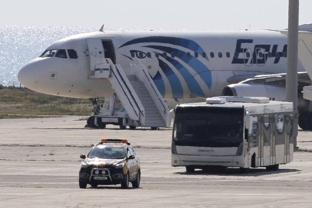 A bus carrying some passengers from the hijacked EgyptAir aircraft as at it landed at Larnaca airport Tuesday, March 29, 2016. An EgyptAir plane was hijacked on Tuesday while flying from the Egypt ...