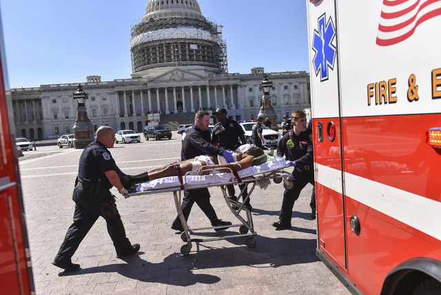 First responders transport the person believed to be the suspect in a shooting at the U.S. Capitol complex Monday, March 28, 2016, in Washington. Visitors and staff were shut in their offices and  ...