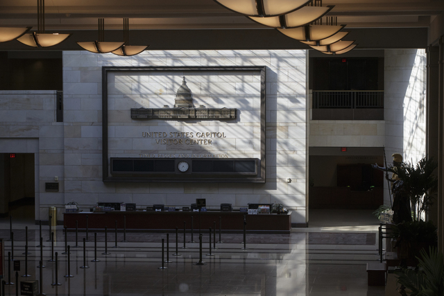 The Capitol Visitor's Center is empty following a shooting at the entrance, Monday, March 28, 2016, on Capitol Hill in Washington. Capitol Police officers say a man was shot by police after drawin ...