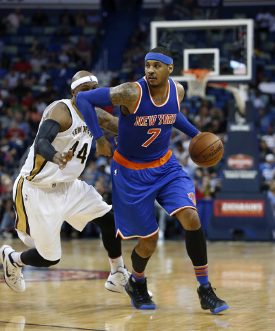 New York Knicks forward Carmelo Anthony (7) drives to the basket past New Orleans Pelicans forward Dante Cunningham (44) in the second half of an NBA basketball game in New Orleans, Monday, March  ...