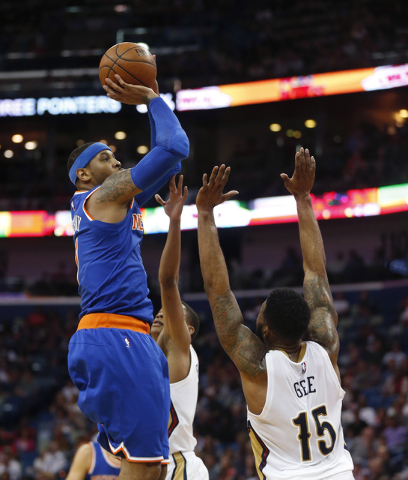 New York Knicks forward Carmelo Anthony (7) shoots over New Orleans Pelicans forward Alonzo Gee (15) in the first half of an NBA basketball game in New Orleans, Monday, March 28, 2016. (Gerald Her ...