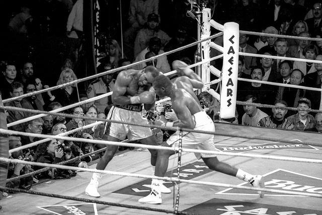 Evander Holyfield, left, defeated Riddick Bowe in a boxing match at Caesas Palace in Las Vegas on November 6, 1993. (Las Vegas News Bureau, file)