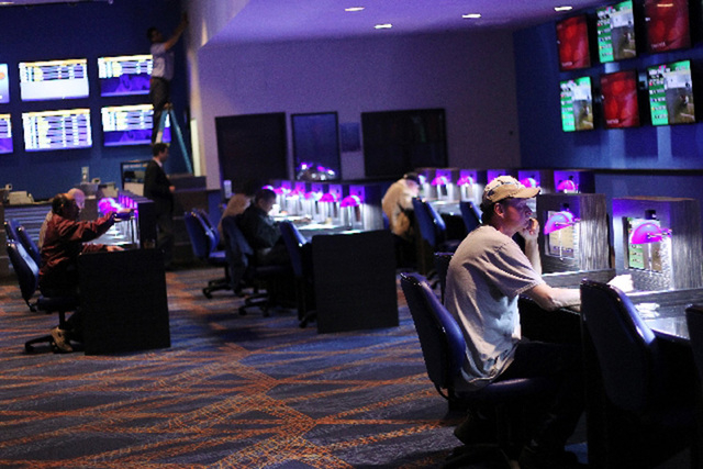 Bettors watch races at the William Hill Sports Book at The Plaza in Las Vegas. (Review-Journal File Photo)