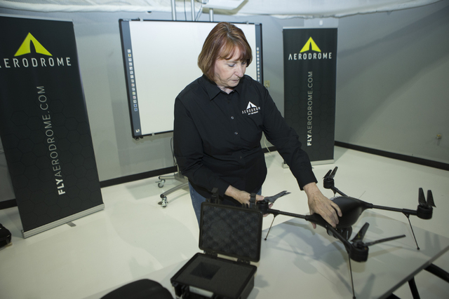 Joanne Leming, director of education for Aerodrome, shows a drone at the Aerodrome headquarters on Wednesday, March 25, 2016, in Henderson. (Chase Stevens/Las Vegas Review-Journal) Follow @Erik_Ve ...