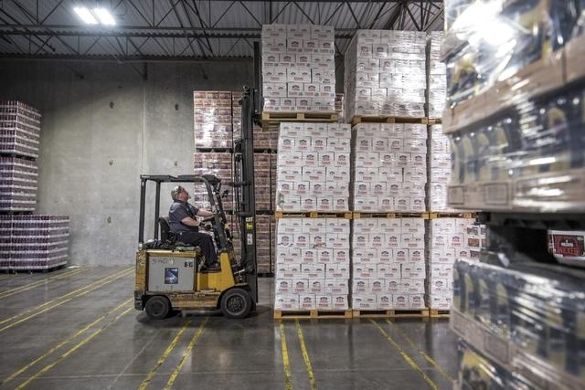 Mike Funke moves pallets of beer at Bonanza Beverage Company in Las Vegas on Wednesday, Feb. 17, 2016. Joshua Dahl/Las Vegas Review-Journal