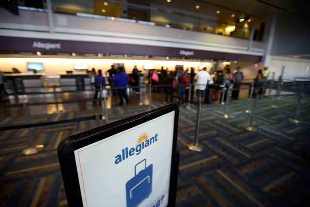 Passengers check in for their flights at the Allegiant Air ticket counter at McCarran International Airport on Monday, April 27, 2015, in Las Vegas. (David Becker/Las Vegas Review-Journal)