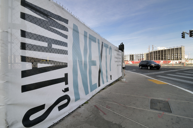 Signage for the Alon hotel-casino project is shown at left on the southwest corner of South Las Vegas Boulevard and Desert Inn Road on Wednesday, March 2, 2016. The Resorts World hotel-casino proj ...