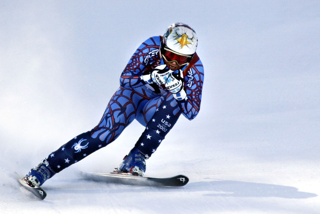 Picabo Street of the United States speeds down the course during the Salt Lake City Winter Olympic Games Women's Downhill in Snowbasin, Utah Tuesday Feb. 12, 2002.  (Diether Endlicher/AP)