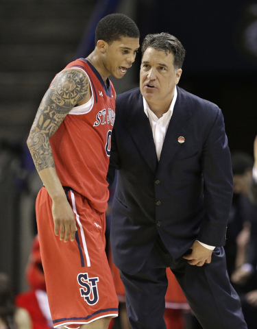 St. John's head coach Steve Lavin, right, talks with Jamal Branch (0) during the second half of an NCAA tournament college basketball game against San Diego State in the Round of 64 in Charlotte,  ...
