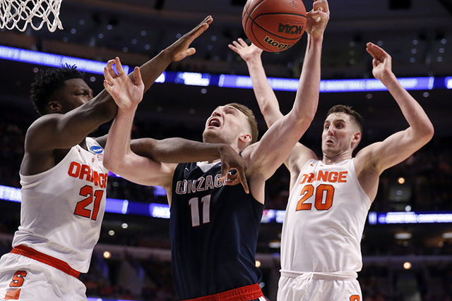 Gonzaga's Domantas Sabonis (11) is fouled by Syracuse's Tyler Roberson (21) as Tyler Lydon (20) blocks a shot  during the second half of a college basketball game in the regional semifinals of the ...