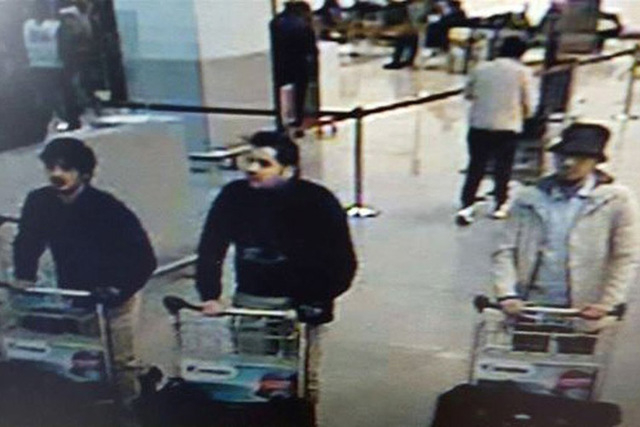 In this image provided by the Belgian Federal Police of three men who are suspected of taking part in the attacks at Belgium's Zaventem Airport. The man at right is still being sought by the polic ...