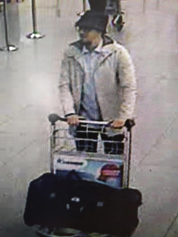 In this image provided by the Belgian Federal Police in Brussels on Tuesday, March 22, 2016, a man who is suspected of taking part in the attacks at Belgium's Zaventem Airport and is being sought  ...