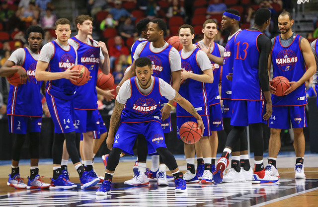 Kansas' Frank Mason III (0) prepares for a half-court throw during practice ahead of a first round men's college basketball game in the NCAA  Tournament in Des Moines, Iowa, Wednesday, March 16, 2 ...