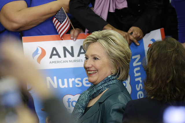 Democratic presidential candidate Hillary Clinton smiles as she greets supporters, Tuesday, March 22, 2016, following a campaign rally at Rainier Beach High School in Seattle. (AP Photo/Ted S. Warren)