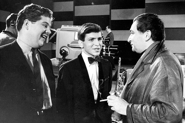 Frank Sinatra Jr. performed with the Tommy Dorsey Orchestra for a TV production in Saarbrucken, Germany on February 20, 1964. Associated Press photo shows Frank Sinatra Jr., center, during a discu ...