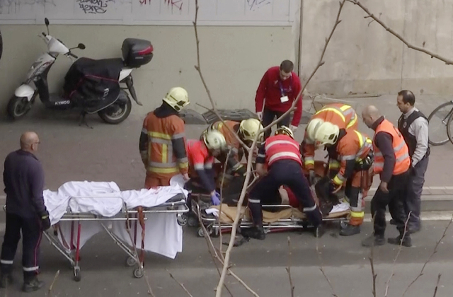 In this image made from video, emergency rescue workers stretcher an unidentified person at the site of an explosion at a metro station in Brussels, Belgium, March 22, 2016. Explosions rocked the  ...