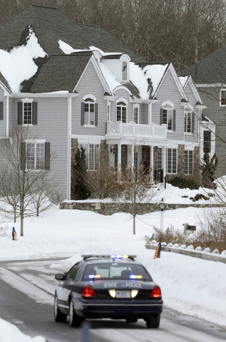 A State Police car sits on the street in front of the North Attleborough, Mass., home of former New England Patriots football player Aaron Hernandez, rear, during a site visit by the jury in his m ...