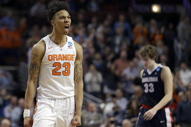 Syracuse's Malachi Richardson (23) reacts in the closing seconds of a college basketball game against Gonzaga in the regional semifinals of the NCAA Tournament, Friday, March 25, 2016, in Chicago. ...
