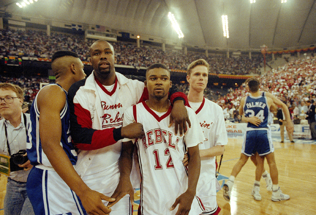 In this March 30, 1991, file photo, UNLV's Anderson Hunt (12) and unidentified teammates leave the floor after losing to Duke in the NCAA national semifinal game in Indianapolis. Anderson Hunt mis ...