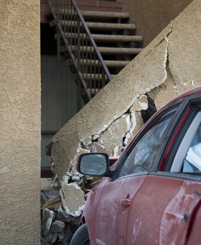 A car that crashed through a fence remains lodged in a building at the Promenade at Sahara apartment complex near Sahara Avenue and Nellis Boulevard on Tuesday, March 8, 2016. Daniel Clark/Las Veg ...