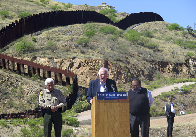Bernie Sanders speaks near the U.S.-Mexico international border in Nogales, Ariz., Saturday, March 19, 2016. Sanders said he will fight for immigration reform as he stood near the border fence tha ...