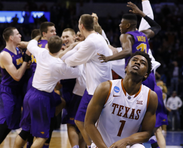 Texas guard Isaiah Taylor (1) reacts as the Northern Iowa team celebrates after guard Paul Jesperson made a last-second half-court shot to win the the first-round men's college basketball game in  ...