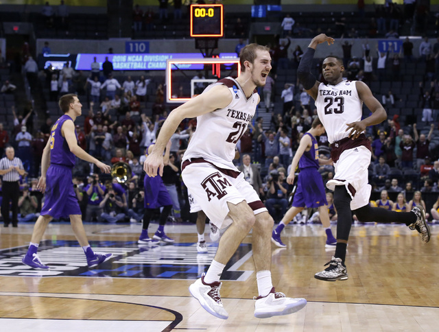 Texas A&M guard Alex Caruso, left, and guard Danuel House (23) celebrate as Northern Iowa players walk off the court after defeating Northern Iowa in double overtime of a second-round men's co ...