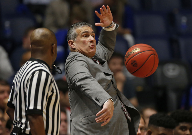 South Carolina head coach Frank Martin dodges a basketball as it sails out of bounds during the first half of an NCAA college basketball game against Georgia in the Southeastern Conference tournam ...