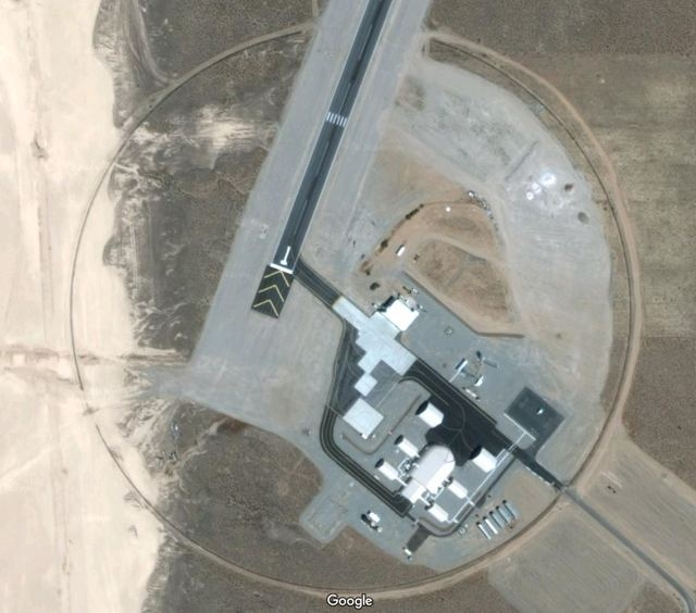 A Google Maps image shows hangar facilities off the Area 6 runway at the Nevada National Security Site.