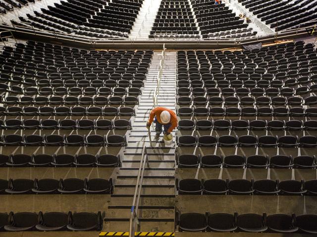 A workman walks up the steps at T-Mobile Arena on Thursday, March 24, 2016. Jeff Scheid/Las Vegas Review-Journal Follow @jlscheid
