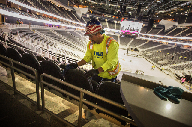 Isaac Vegas with CSI cleans seats at T-Mobile Arena on Monday, March 28, 2016. The Killers will open the arena with a concert on April 6. Jeff Scheid/Las Vegas Review-Journal Follow @jlscheid