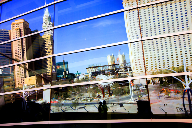"""A reflection of """"The Park"""" off the T-Mobile Arena behind New York-New York is seen Monday, Feb. 29, 2016. The joint venture partners AEG and MGM Resorts is scheduled to open the arena next month.  ..."""
