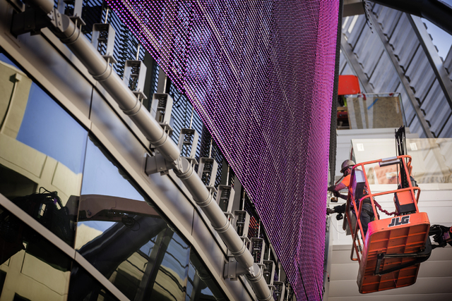 Men install lighting on the 209-foot-by-45 foot digital board on the T-Mobile Arena behind New York-New York on Monday, Feb. 29, 2016. The joint venture partners AEG and MGM Resorts are scheduled  ...