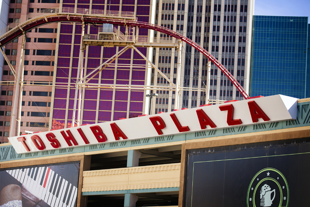 A Toshiba Plaza sign is seen on the New York-New York parking garage is seen on Monday, Feb. 29, 2016. The joint venture partners AEG and MGM Resorts is scheduled to open the T-Mobile Arena next m ...