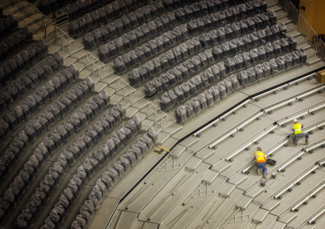 Men work on the seats at the T-Mobile Arena behind New York-New York on Monday, Feb. 29, 2016. The joint venture partners AEG and MGM Resorts is scheduled to open the arena next month. Jeff Scheid ...