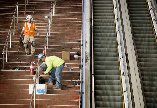 Men work on the stairwell at the T-Mobile Arena behind New York-New York on Monday, Feb. 29, 2016. The joint venture partners AEG and MGM Resorts is scheduled to open the arena next month. Jeff Sc ...