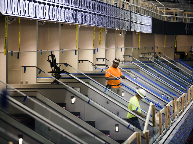 Men work on one of  42 suites at the T-Mobile Arena behind New York-New York is seen Monday, Feb. 29, 2016. The joint venture  partners AEG and MGM Resorts is scheduled to open the arena next mont ...