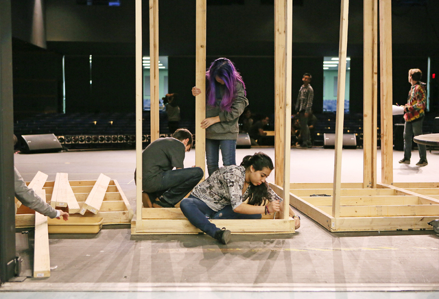 "Students Mason Durham, clockwise from center left, Katie Grounds and Gabriela Ahumada work on building the set for the musical ""Fame"" at Del Sol Academy of the Performing Arts Th ..."