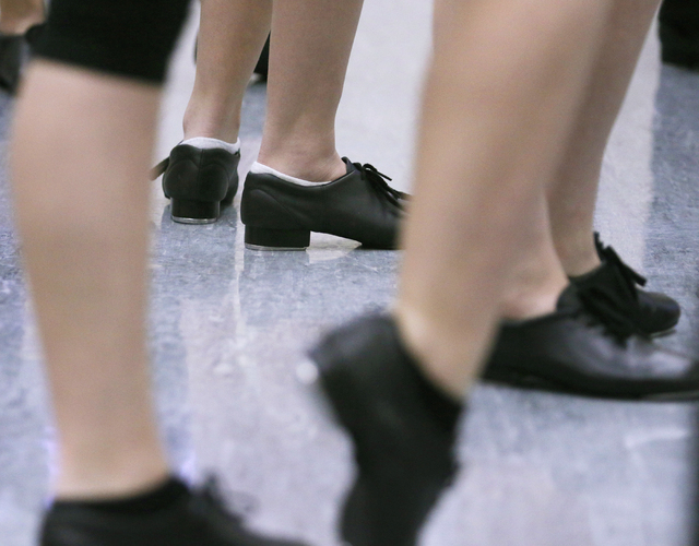 Tap dancers warm up during Chris Harperճ tap class at Faith Lutheran Middle School and High School Wednesday, Feb. 10, 2016, in Las Vegas. The performing arts school offers a range of tradit ...